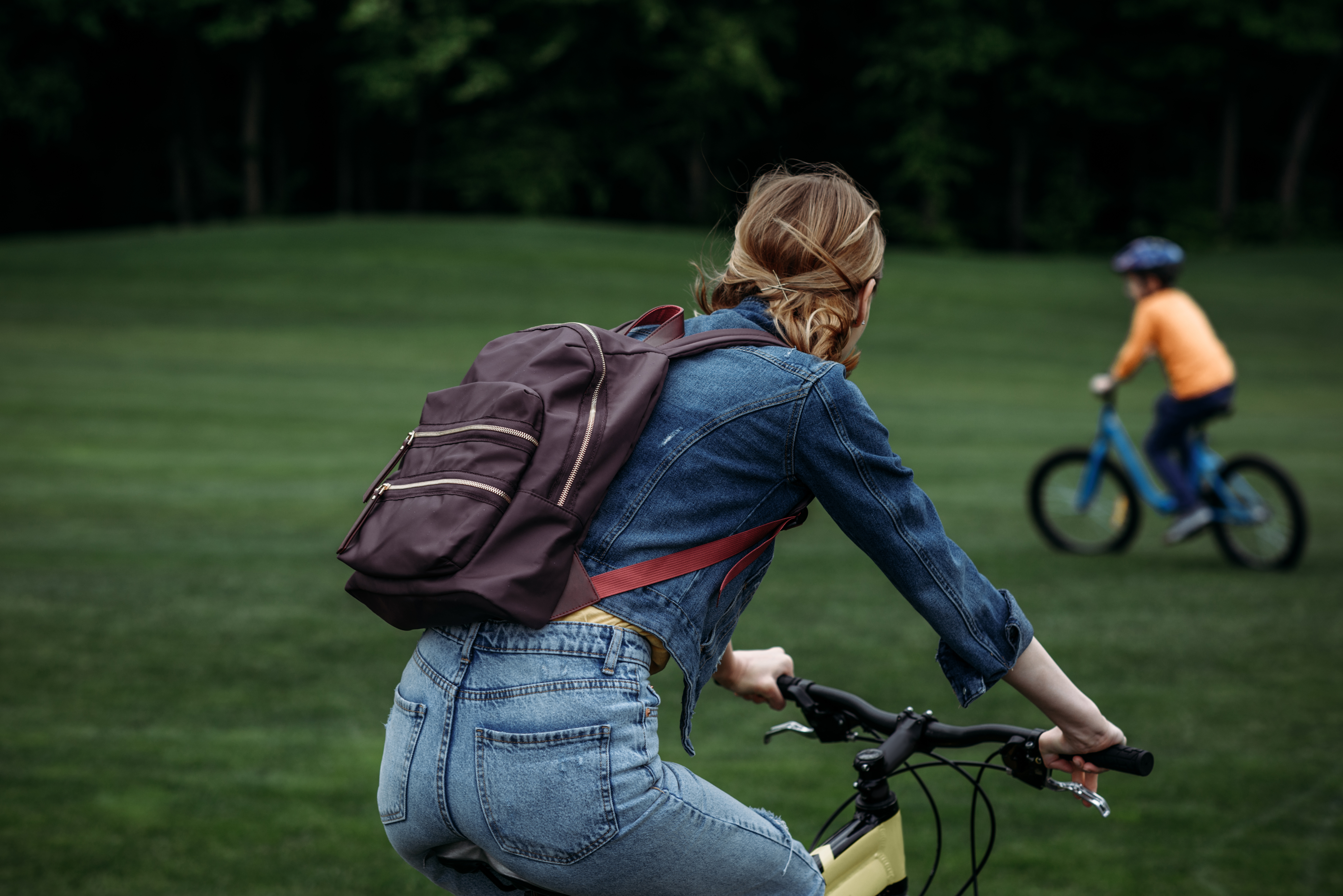 Lady riding a bike with a nephew or son outdoors