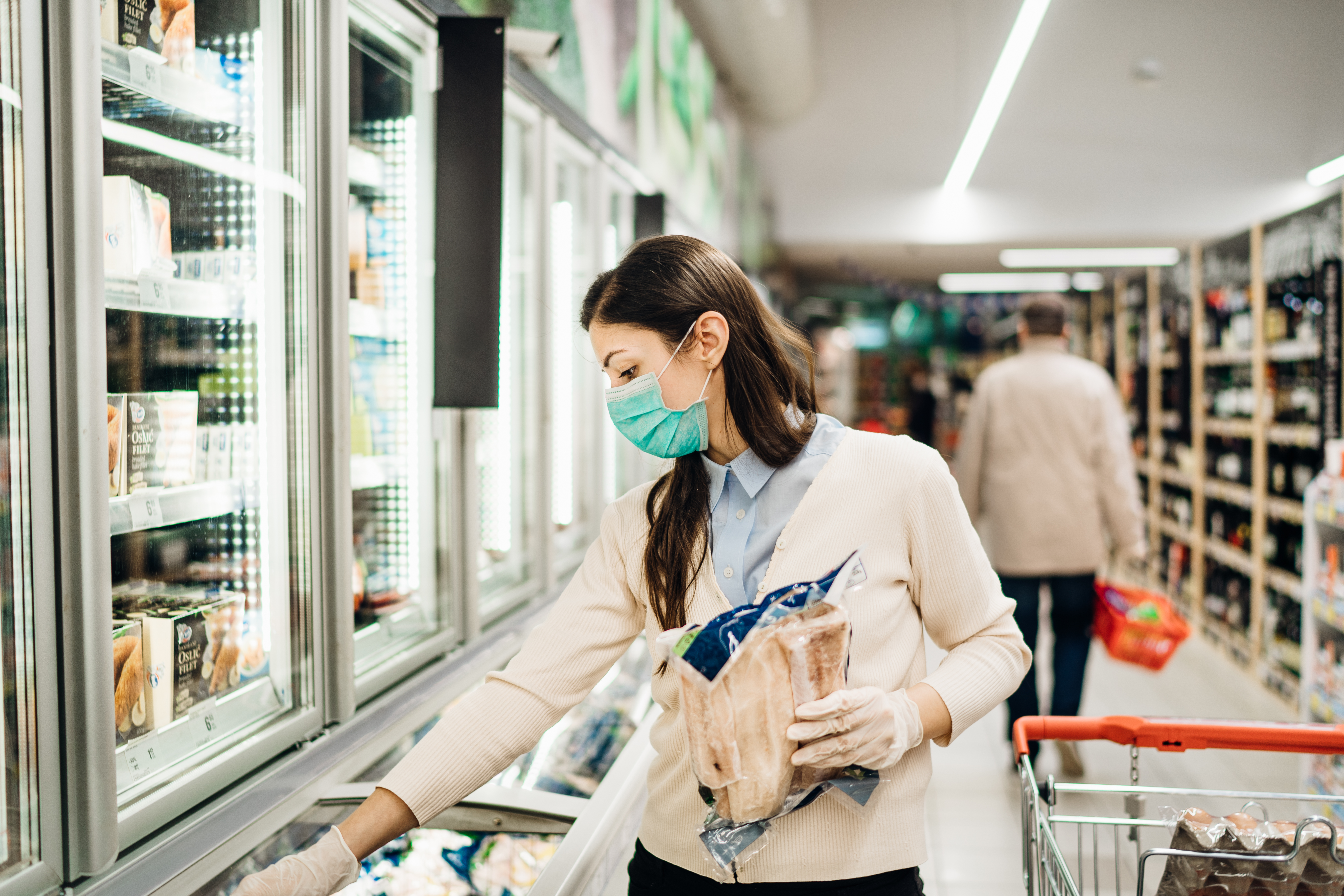 Woman in a mask while at the supermarket.